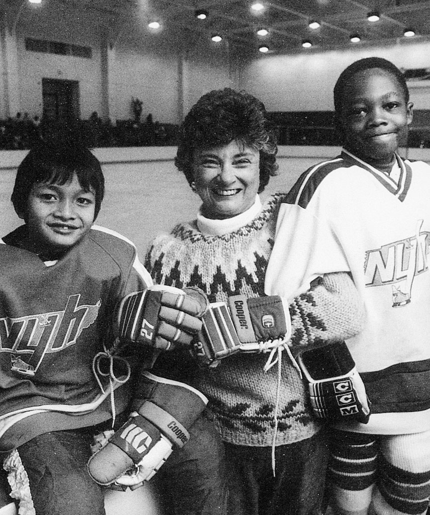 Margaret Maddox with youth hockey players