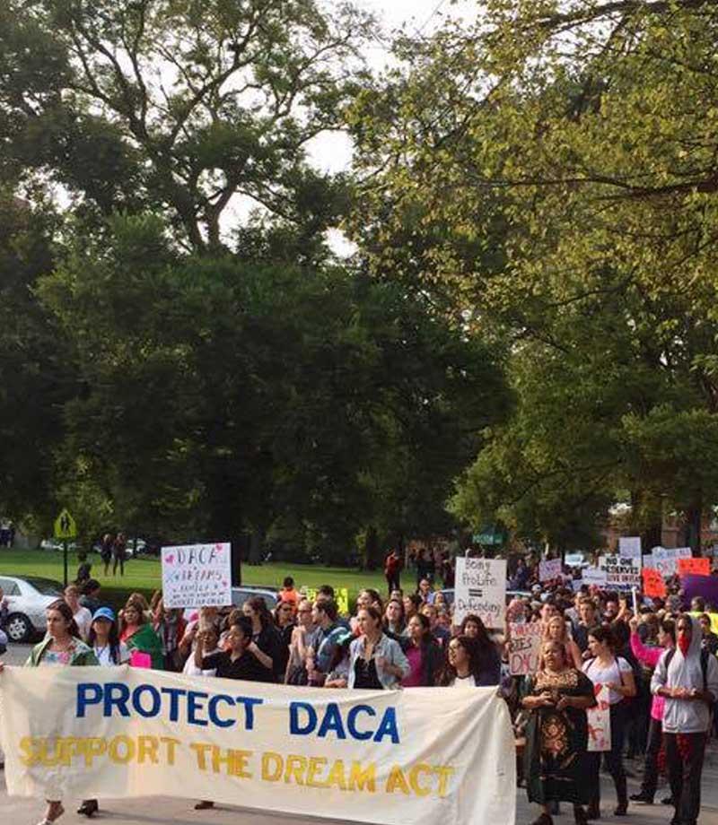 TIRRC holding DACA sign